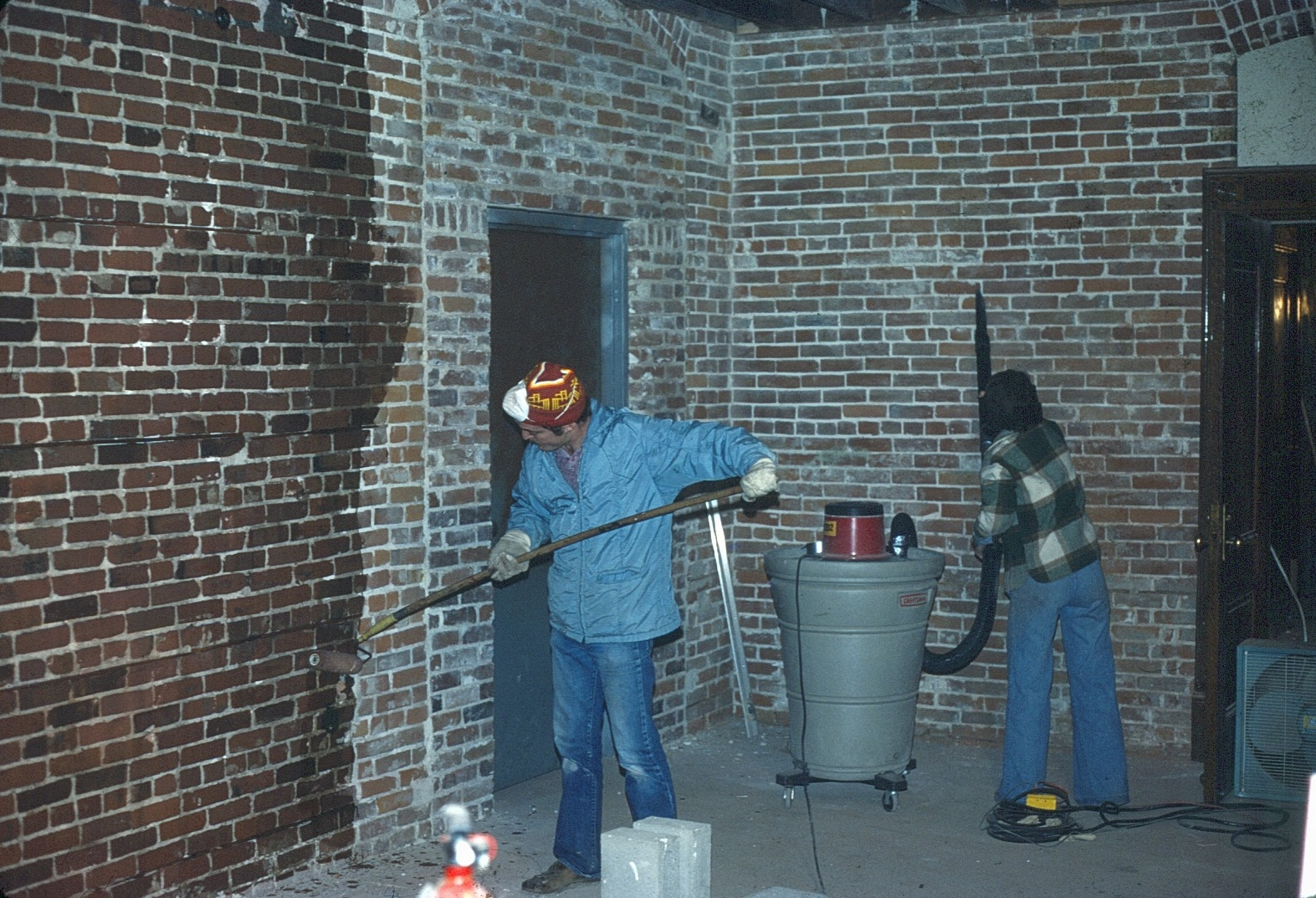 workers restoring the pumphouse