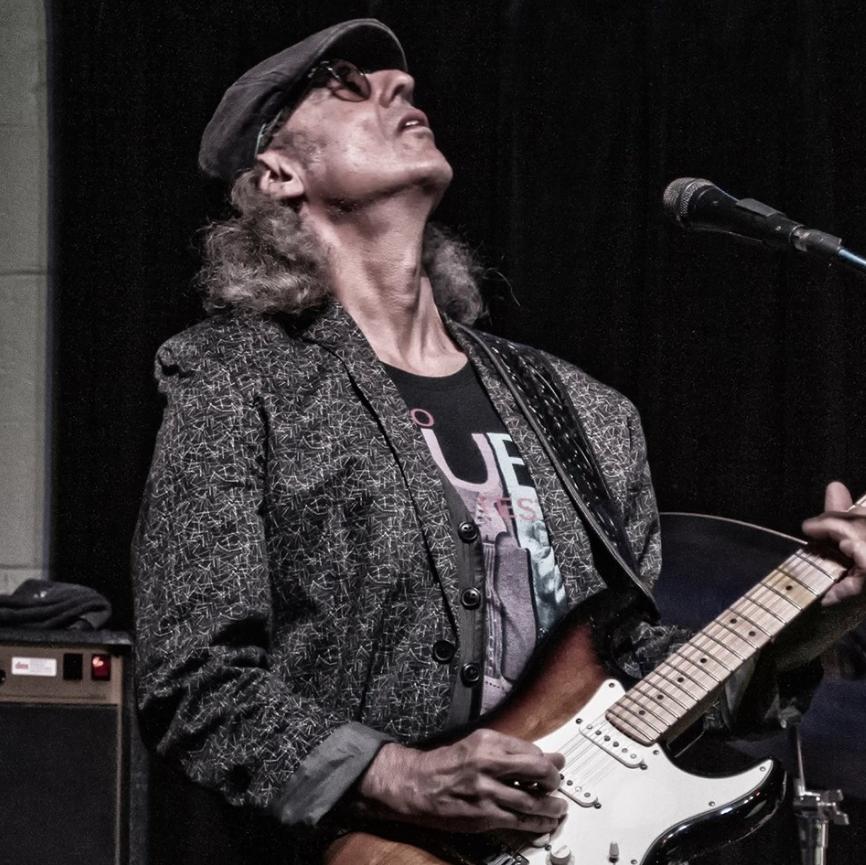 Michael Charles playing Guitar
